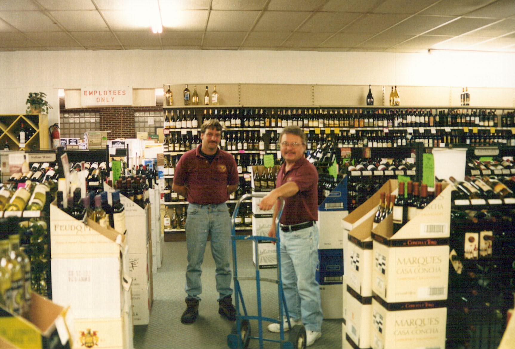 Bremer's employees Wayne and Ziggy, working at the former store location on Commercial Dr. circa 1999-2000